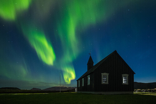 The Budakirkja or the black church with beautiful northern lights in Snaefellsnes Peninsula Iceland