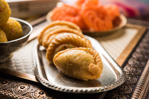 Gujiya a crescent shaped bread food made for Holi festival in India
