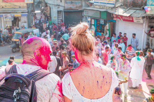 Man and Woman sitting during the holi festival in Udaipur India