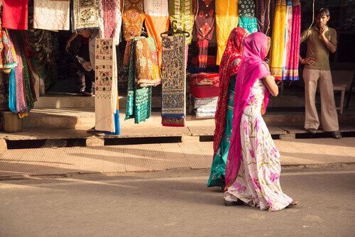 Two women walking on the streets of Pushkar Udaipur India