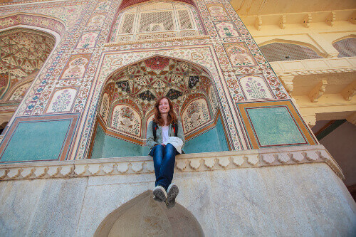 A young tourist enjoys the sights of the historic Naharagarh Fort in Jaipur, India.