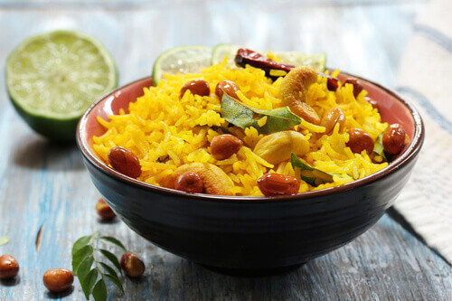 Lemon rice indian hot meal with basmati rice seasoned with lemon juice turmeric curry leaves and nuts in India