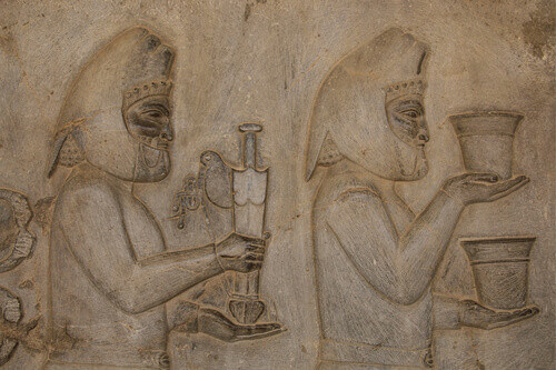Bas-relief depicts ambassadors bearing gifts to the king in the ancient city of Persepolis in Shiraz Iran