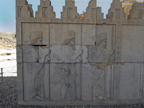 Reliefs of marching Median and Persian guardians decorating the walls of royal palace Apadana in Persepolis