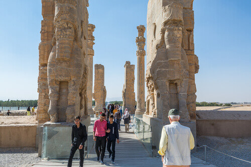 Tourist at the Ruins of the Gate of All Nations in Persepolis in Shiraz Iran