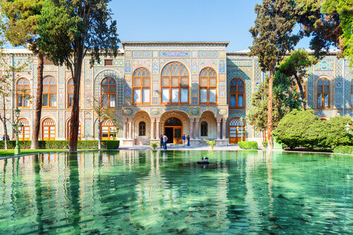 Beautiful view of the Golestan Palace and scenic pond with emerald water in Tehran Iran