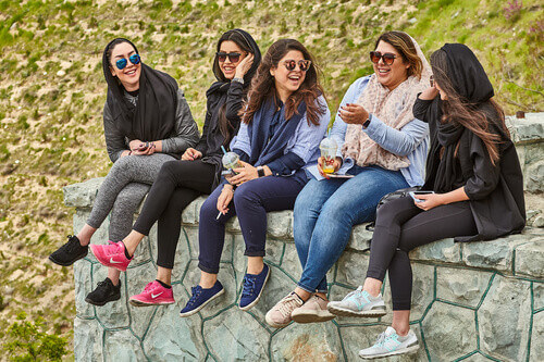 Group of iranian women sitting and laughing on a friendly conversation
