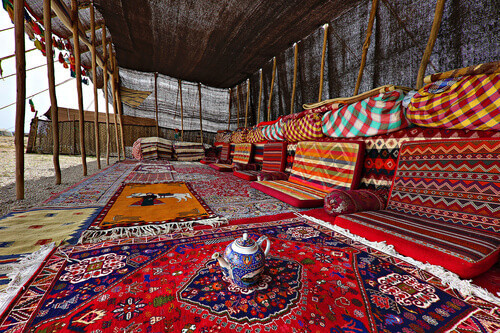 Nomadic Qashqai tent with carpets and rugs on sale in Iran