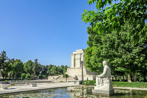 Tomb of Ferdowsi with his statue on the pond in Tus Iran