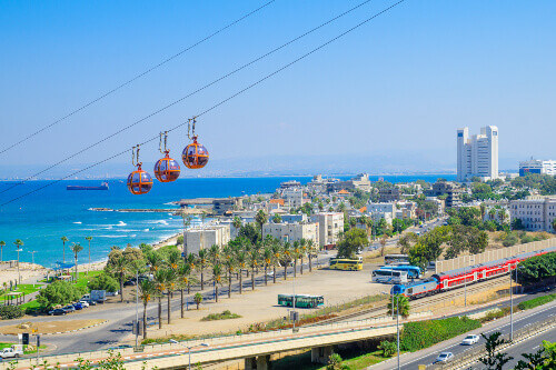View of the bay, downtown and the cable car, with locals and visitors, in Haifa, Israel