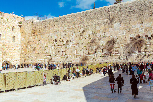 Men and Women are separately praying at the Western Wall in Jerusalem Israel