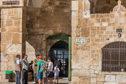 Tourists at the Gate of the Moors or Mughrabi Gate next to the Al-Aqsa mosque, located on the Temple Mount in Jerusalem Israel