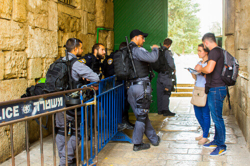 Israeli security police talking to tourists of the Dome of the Rock Complex in Jerusalem Israel