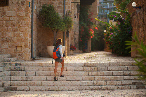 Tourist walking on the ancient stone streets of Old Jaffa in Tel Aviv, Israel