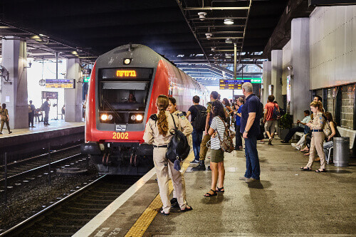 Tourists and locals waiting at the train station in Tel Aviv, Israel