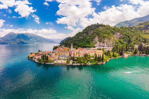 Beautiful aerial drone view of the famous old Italian town of Varenna on the banks of Como Lake in Bellagio Italy