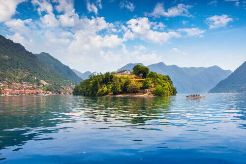 Colourful summer view of the island Comacina on Lake Como in Lombardy region in Italy