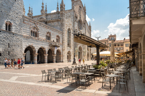 View of Duomo square with traditional Italian street cafe in the historic centre of Como Lombardy Italy