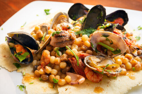 Fregola pasta with seafood a traditional recipe from Sardinia
