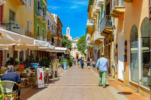 View of the old village with shops and restaurants in Carloforte on the Island of San Pietro at the background is the church of San Carlo Borromeo located in Sardinia Italy