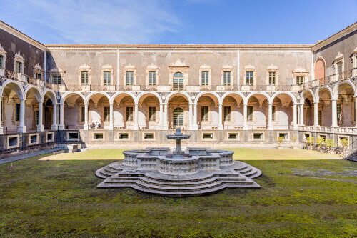 Baroque central courtyard with colonnade in the Benedictine closter now part of Università dei Benedettini in Catania Sicily Italy