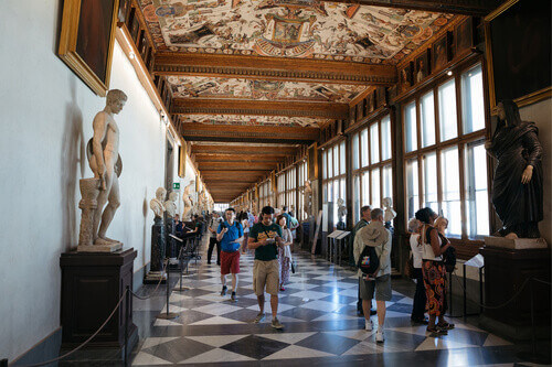 Panoramic view of interior and arts hall of Uffizi Gallery in Florence Italy