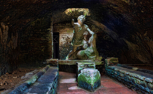 Statue of the god Mithras killing a bull in the thermal s mithraeum in archaeological excavations of Ostia Antica in Rome Italy