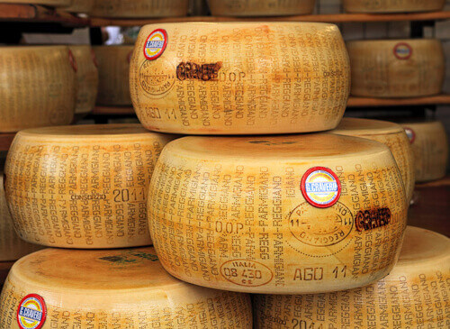 Wheels of Parmesan famous italian hard cheese made from raw cows milk in Parma Italy