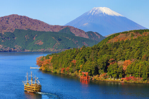 Mountain Fuji and Lake Ashi with Hakone temple and sightseeing cruise boat in autumn in Japan