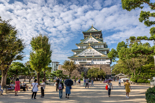 Tourists walking around the Osaka Castle in a beautiful sky day in Osaka Japan