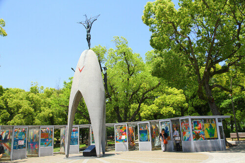 Childrens Peace Monument serves to honor Sadako Sasaki and the hundreds of victims of the atomic bombing in Hiroshima, Japan