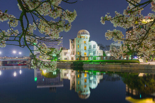 Night view of Atomic Bomb Dome or A-bomb dome (Genbaku Dome-mae) part of the Hiroshima Peace Memorial Park in Hiroshima, Japan