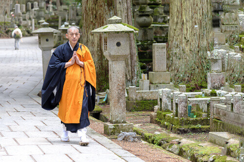 View of a Shingon Monk walking in Okunoin cemetery in Koyasan, Japan
