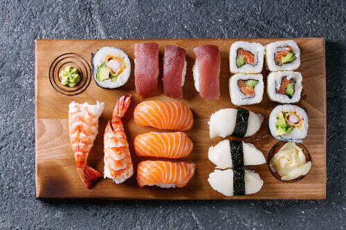 Sushi set nigiri and sushi rolls on a wooden serving board in Japan
