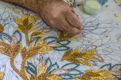 Artisan make artistic mosaics in Madaba Jordan