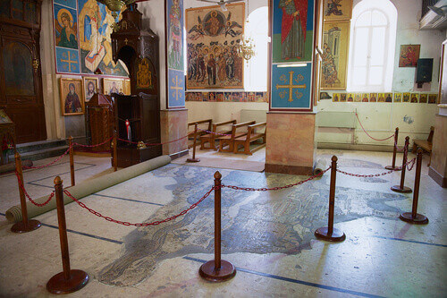 Interior of Greek Orthodox Basilica of St George with the mosaic map of Holy Land in Madaba Jordan