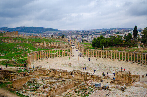 Oval plaza with a lot of tourist in roman city of Jerash in Jordan