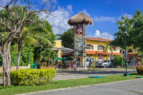 Main street in Playacar resort area with lots of bars and restaurants located in Playa Del Carmen Mexico
