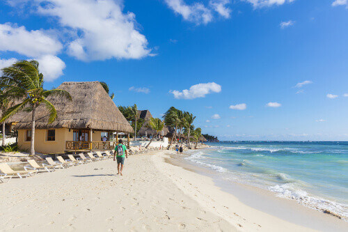People on the beach in Playa del Carmen. The city boasts a wide array of tourist activities in Playa del Carmen Mexico