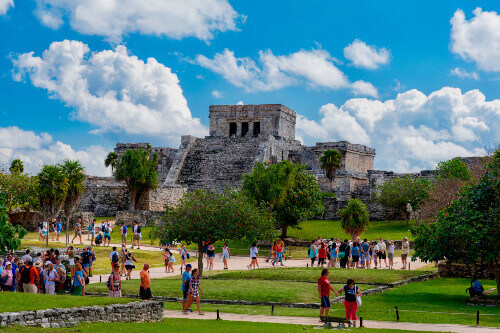 Tropical landscape of the Mayan riviera at the Zona Arqueológica de Tulum in the tourist area of Tulum Mexico