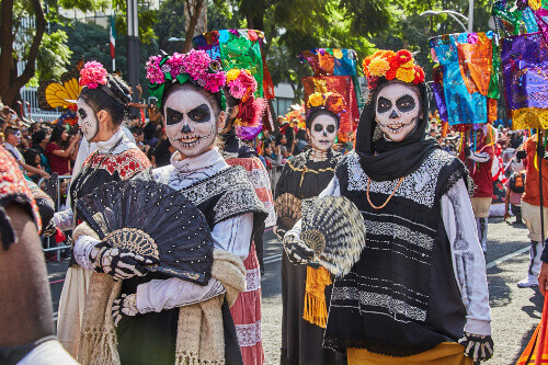 Girls with skeleton for make up goes in the Day of the dead or Dia de los muertos parade in Mexico City