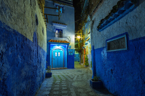 Fantastic night view at a traditional moroccan building. Blue street walls of the popular city of Chefchaouen in Morocco