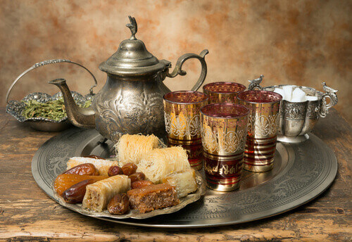 Oriental tea tray with dates and cookies symbolising Moroccan hospitality Erfoud Morocco