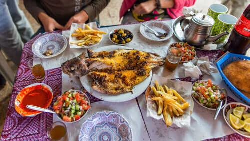 Dinner with fish and seafood served at the fish market in Essaouira Morocco