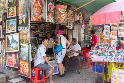 A tourist shopping for authentic myanmar painting in a shop in Yangon Myanmar