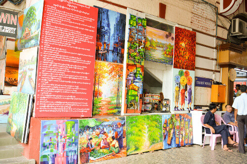The Bogyoke Market or Scotts Market in Yangon Myanmar selling a variety of local products of paintings, T-shirts, traditional music instruments among others