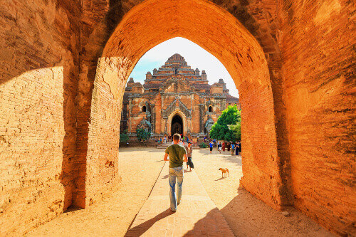 A tourist on barefoot visiting Dhammayangyi temple, a popular ancient temple at Bagan, Myanmar