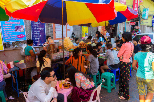 Bogyoke Aung San Market, formerly Scotts Market, with locals eating located in Pabedan township in Yangon, Myanmar