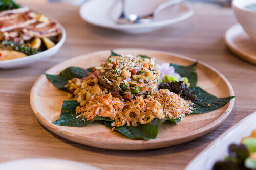 Lahpet is a Burmese Tea Leaf Salad served with deep fried garlic, peanut, white sesame, and dried shrimp found in Myanmar