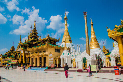 Schwedagon pagoda is a holy place were tourists and locals are walking on barefoot with many temples inside in Yangon Myanmar